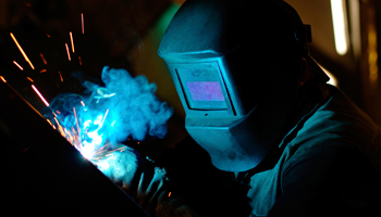 welder mask welding smoke close up metalworker metal